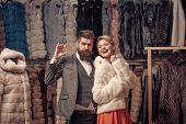 Expensive Clothes And Money Concept. Couple Shopping In Fur Mall. Woman In White Fur Coat With Beard poster