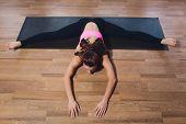 Yoga Woman Practicing Yoga. Beautiful Blonde Woman In Dark Green Sports Jumpsuit Doing Yoga Asana On poster