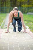 Woman Runner On Start Position At Stadium. Runner In Start Pose On Running Surface. Woman Run Outdoo poster