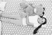 Relax Concept. Little Girl Relax In Bed. Cute Child Relax With Teddy Bear Toy. Relax And Enjoy Life. poster