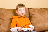 Happy Young Boy Playing Video Game poster