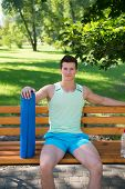 Relax Concept. Athlete Relax On Bench In Park. Sportsman Relax After Yoga Training. Relax And Enjoy  poster