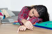 Sleeping Teenage School Girl At Desk At Home At Desk poster