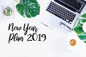 2019 New Year Plan - Flat Lay Home Office Workspace With Laptop And Green Leaves Monstera Over White poster
