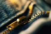 Brass Zipper On Blue Denim In Macro Magnification poster