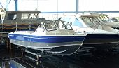 Fishing Boat. Motor Boat For Sale In The Store. Located On A Wheeled Cart. poster