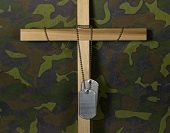 dog tags on wooden cross