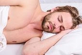 Man Handsome Guy Lay In Bed In Morning. Tips On How To Wake Up Feeling Fresh And Energetic. Morning  poster