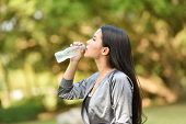 Woman Drinking Water Bottle Health Concept Smiling Young Girl Relax Exercise And Hold Water Bottle F poster