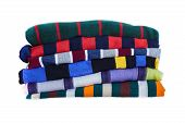 Stack Of Multicolored Striped Winter Clothes Isolated On White Background. Pile Of Warm Cozy Clothes poster