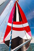 Spinnaker With Uphaul On Sail Boat, Blue Sky In Background. Marine Sailing Objects Concept. poster