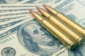 Combat Bullets From The Army Machine Macro On The Banknotes Of $ 100. The Concept And Symbol Of A St poster