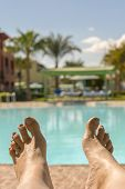 Beautiful Tanned Legs. Close-up Of Female Legs With A Swimming Pool On The Background. Beautiful Fem poster