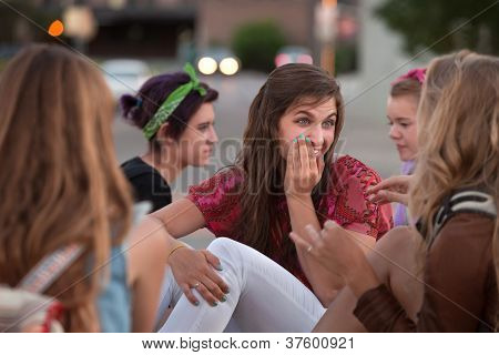 Whispering Teen Female With Friends