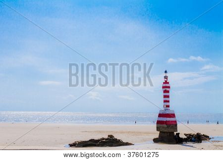 Lighthouse  with blue sky background. Ecuador