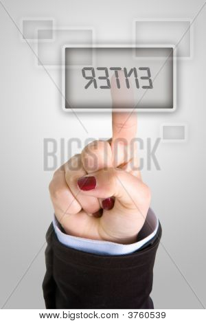 Businesswoman Pushing Enter Button With Finger