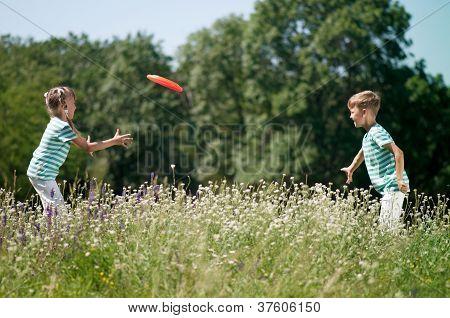 Children playing frisbee