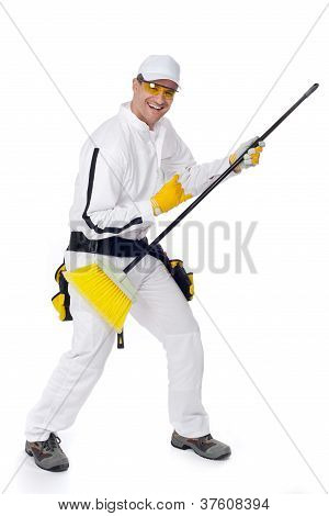Worker Goes Crazy With A Broom Guitar