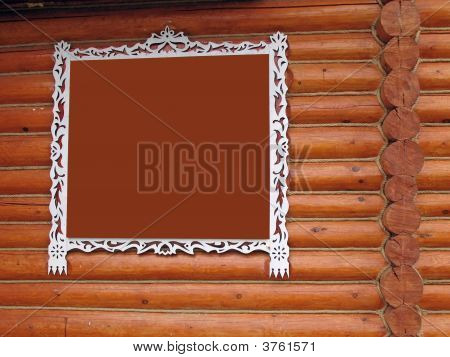 White Fretted Frame On Loghouse Wall.You Can Put In It Anything You Want