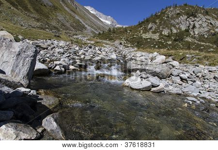 Small mountain stream in the north italian alps