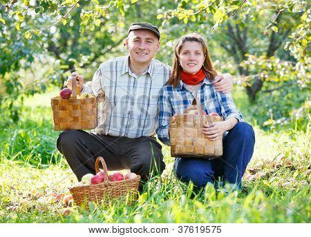 happy couple in the garden harvests