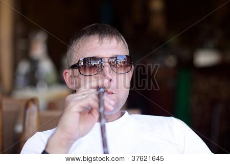 Man Smoking Nargile