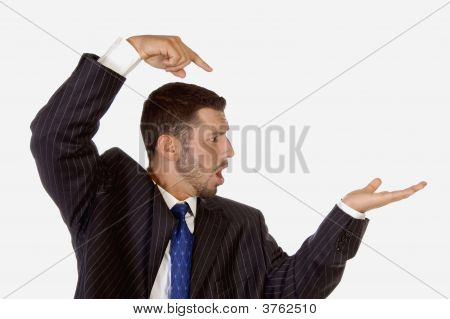 Surprised Businessman Pointing His Palm