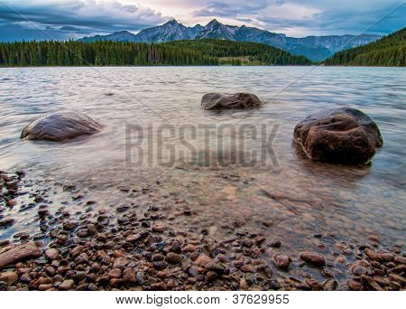 Mountain Peaks With Three Rocks In Lake