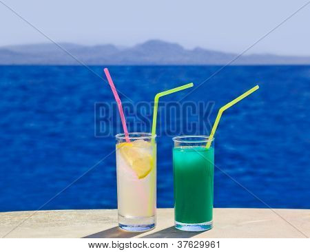 Two Cocktails On Marble Table At Beach
