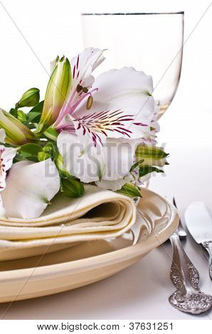 Table Setting With White Alstroemeria Flowers