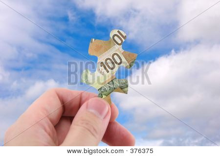 Hand Hold Canadian Dollar Puzzle