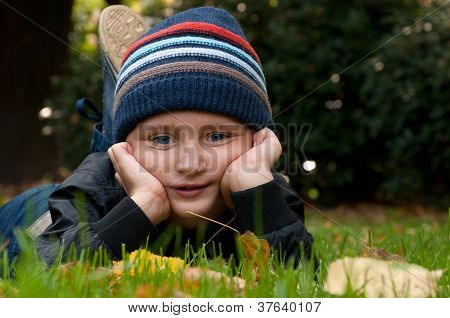 little boy relaxing in the park