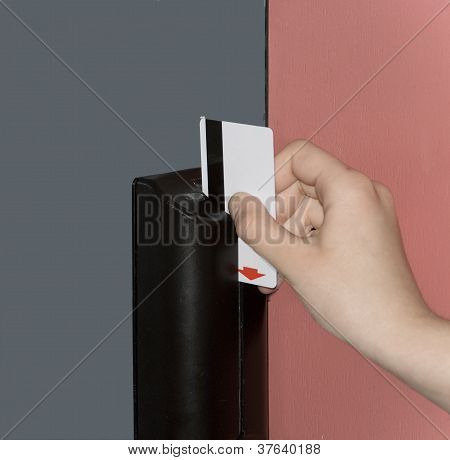 Door opening  by means of the plastic magnetic card.