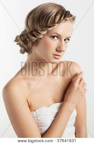 Portrait Of Young Woman With Braid Hairdo