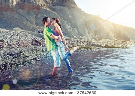 Passionate Couple Kissing On The Beach