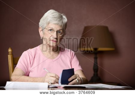 Senior Woman Paying Bills