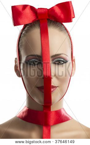 Beauty Portrait Of Girl With Red Bow, Is In Close-up
