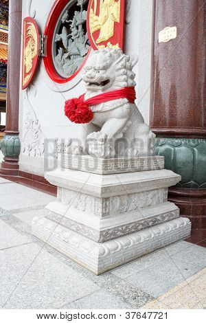 Chinese Lion Statue From Granite Rock At Temple, Thailand