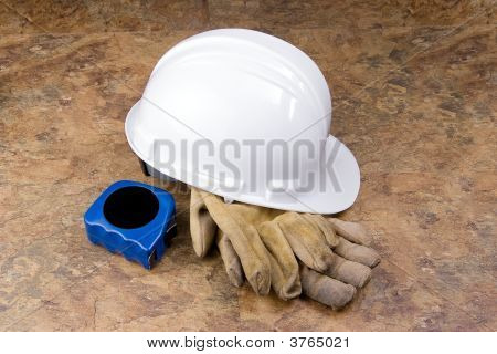 Hard Hat Gloves And Tape Measure