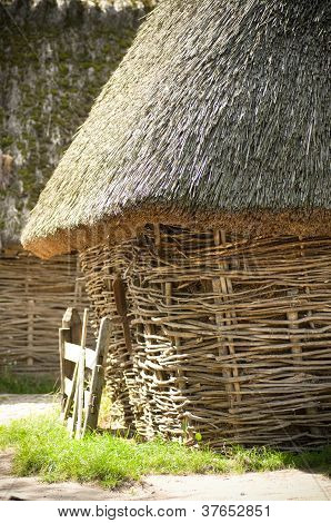 Outbuildings built of twigs and straw roof