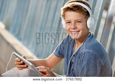 Close Up Portrait Of Teen Boy With Tablet.