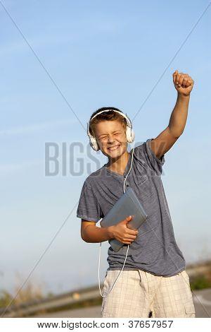 Cute Boy Dancing To The Rhythm Outdoors.