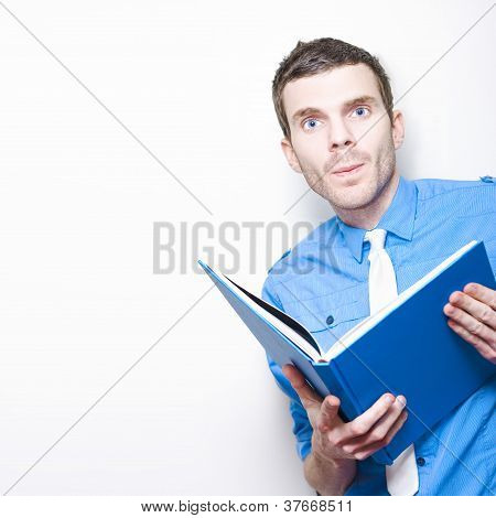 Young Businessman Reading Marketing Strategy Book