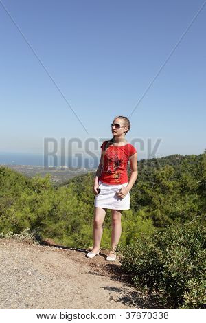 Portrait Of Teen On Valley Background