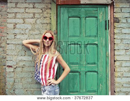 Blond Girl Holds In American Retro Style