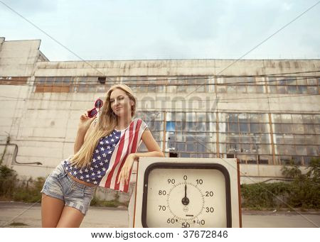 Blond Girl On Damaged Gas Station