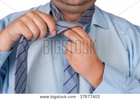 Fat Man Adjusting Tie