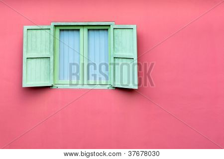 Vintage Window With Green Shutters On Pink Wall
