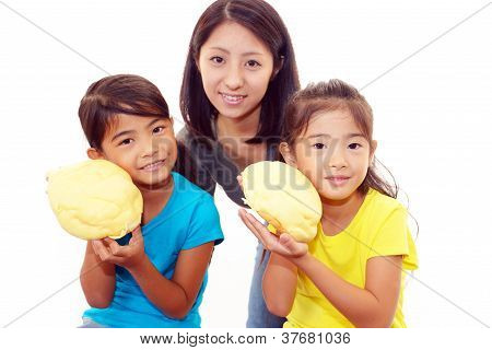Little girls eating bread