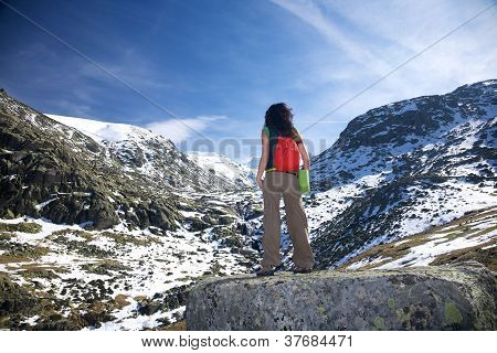 Trekking Woman At A Snow Valley